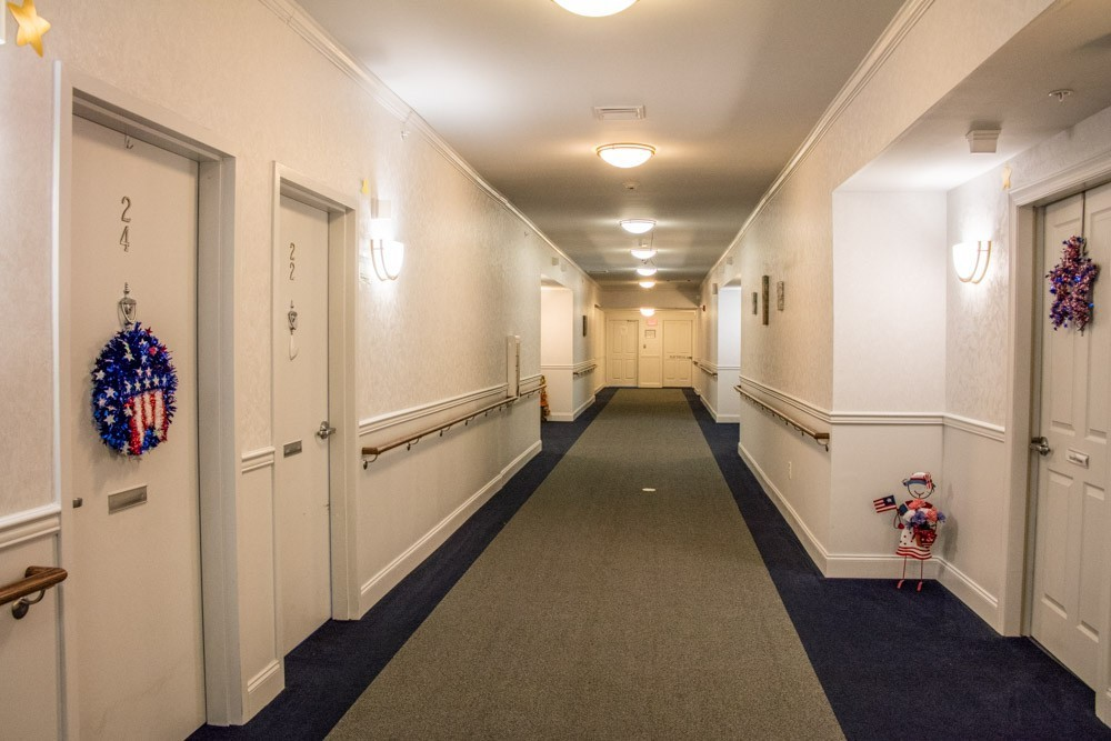 This is a typical hall - bright and well-lit with wall-to-wall carpet.