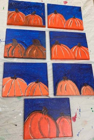 paintings of halloween pumpkins that the residents created