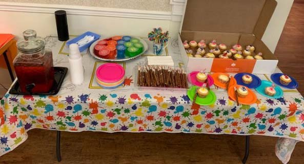Table with cupcakes and other goodies on it