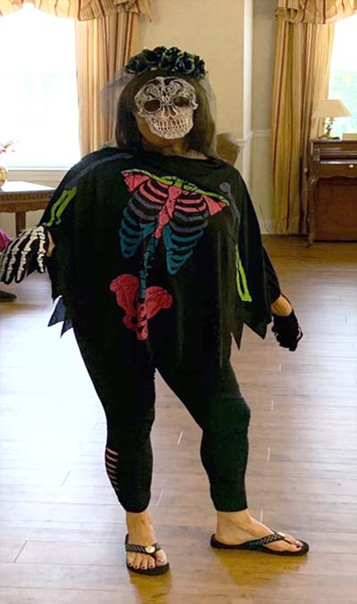 Employee dressed as a skeleton for halloween