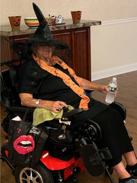 Resident in wheelchair dressed as witch